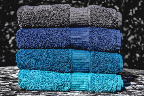 Woraus besteht Frottee und Frottiertücher wie diese türkis - blau - grauen?