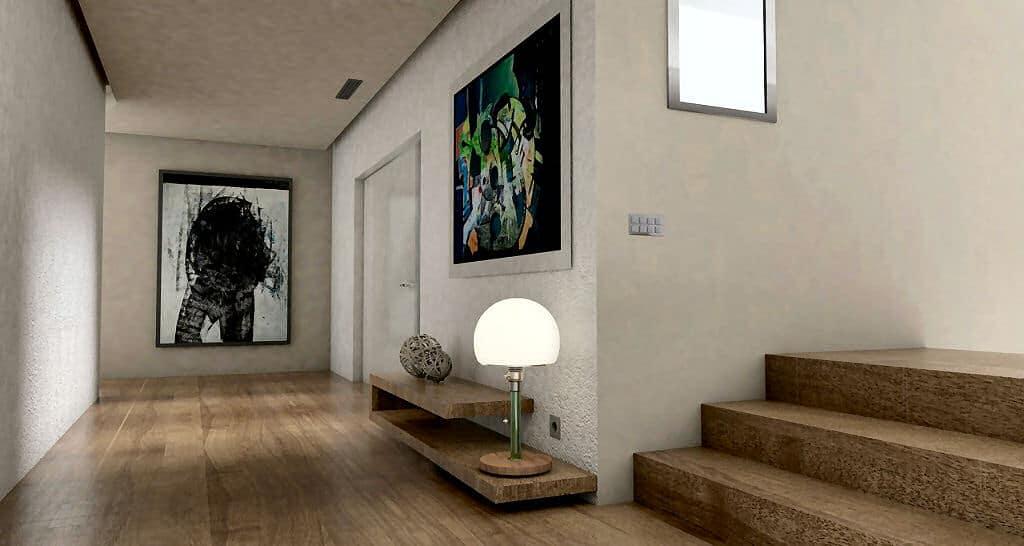 Ein Flur und Eingangsbereich mit viel Licht - so kommen auch die Bilder an der Wand zur Geltung.